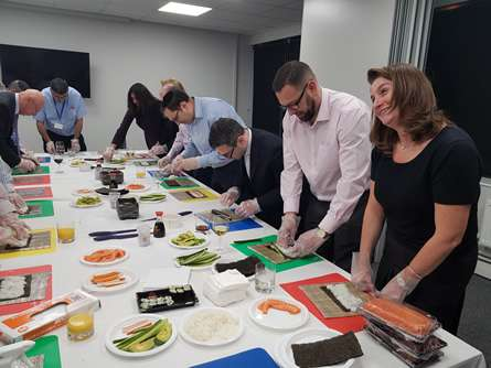 Finchley lawyers pick up the chopsticks to treat insurance brokers to an evening of sushi making